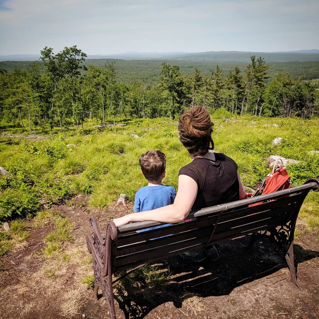 mother-and-son-sitting-on-bench
