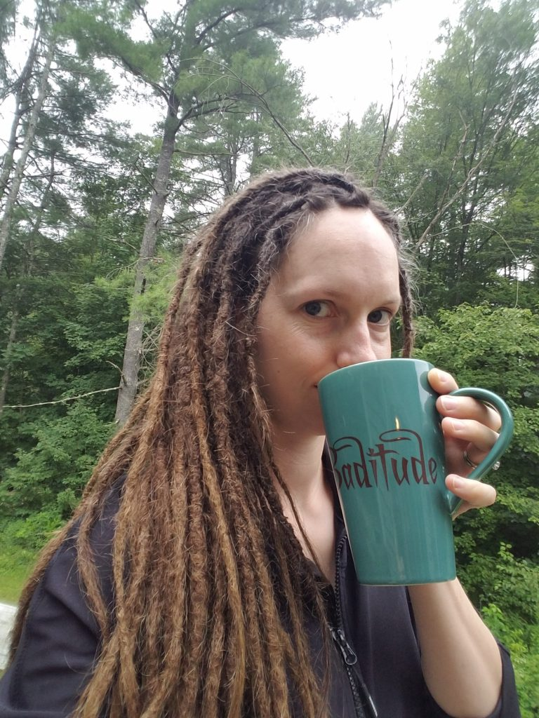 woman-with-dreadlocks-sipping-coffee